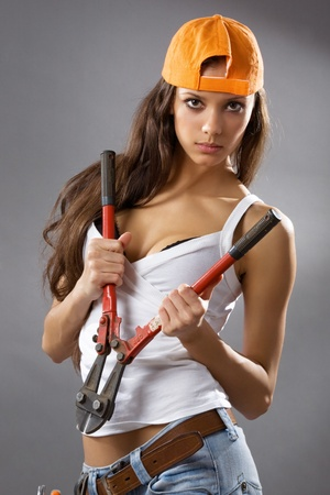 architect tools: sexy young woman construction worker
