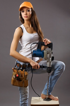 sexy young woman construction worker Stock Photo - 9461227