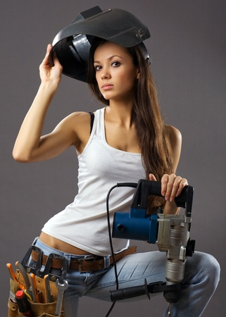 laborer: sexy young woman construction worker