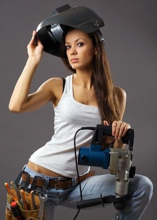 trabajador de la construcción de una mujer joven sexy  Foto de archivo