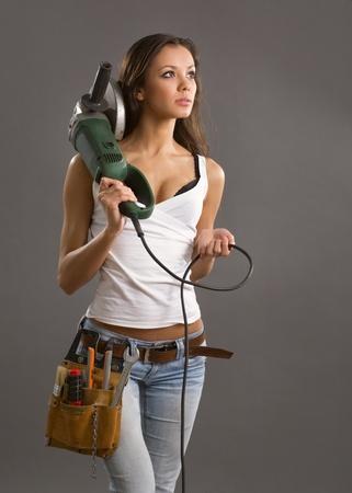 Trabajador de la construcción de una mujer joven sexy  Foto de archivo - 9464902
