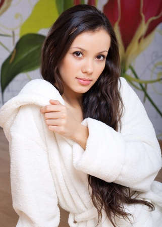 young woman in a white robe