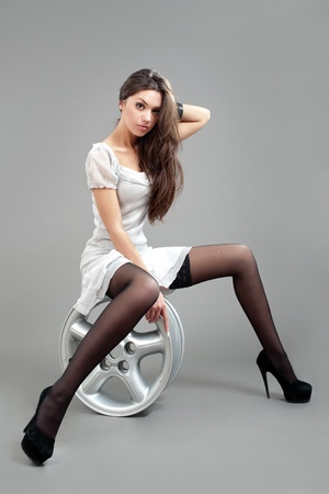 portrait fashion model in gray dress 스톡 콘텐츠