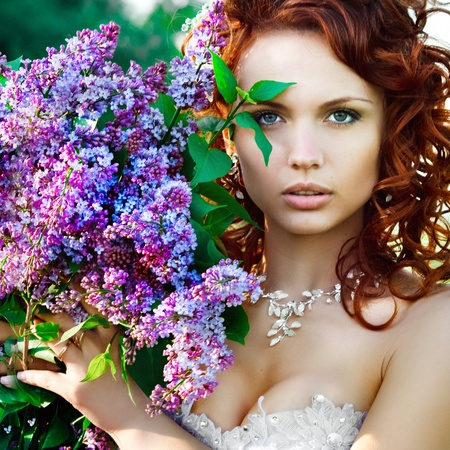 portrait of a bride with a bouquet of lilacs Stock Photo