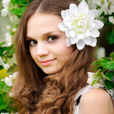 young teen girl nude: beautiful girl with a flower in her hair