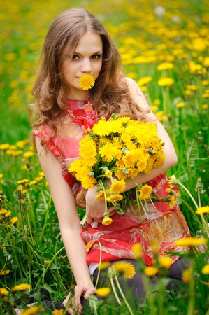 beautiful girl in the field with yellow flowers