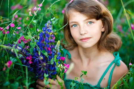 little girl in the field with flowers Stock Photo - 9810328