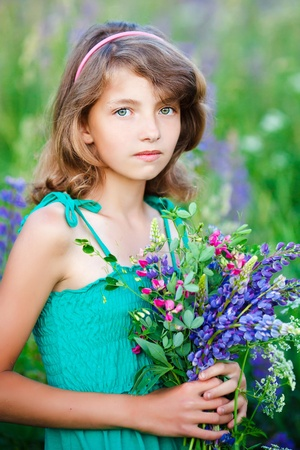 little girl in the field with flowers Stock Photo - 9810334