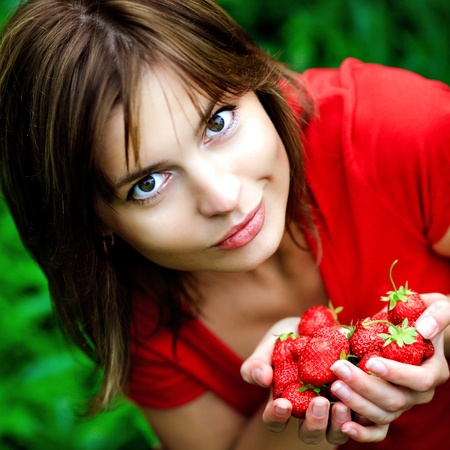 sweet red strawberry in beautiful woman hands