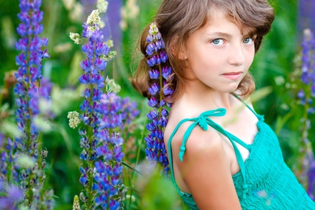 little girl in the field with flowers Stock Photo - 9810446