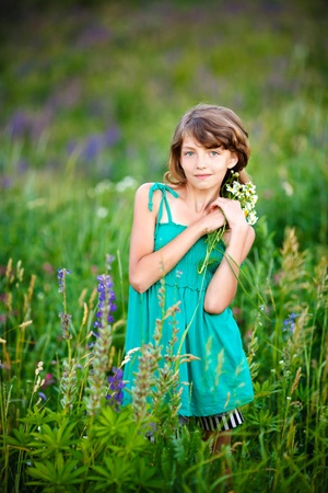 little girl in the field with flowers Stock Photo - 9810443
