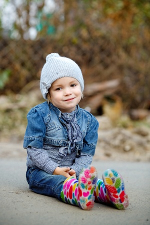 beautiful  Little girl in blue  jeans outdoor Stock Photo - 11153633
