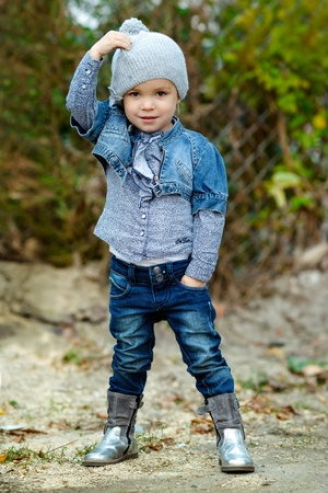 beautiful  Little girl in blue  jeans outdoor