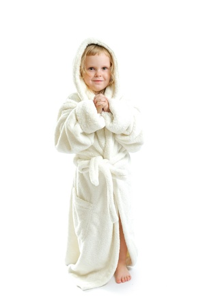little cute girl in a bathrobe isolated on a white background  photo