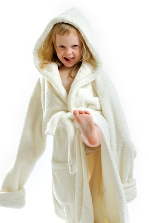 little cute girl in a bathrobe isolated on a white background  Stock Photo