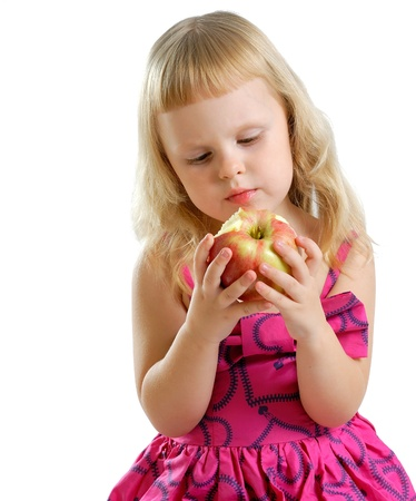 little girl and a delicious red apple photo