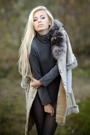 girl in a fur coat in the autumn background photo