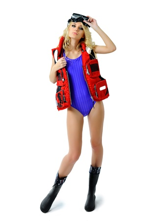 skin diving: girl in a fishing outfit on white background