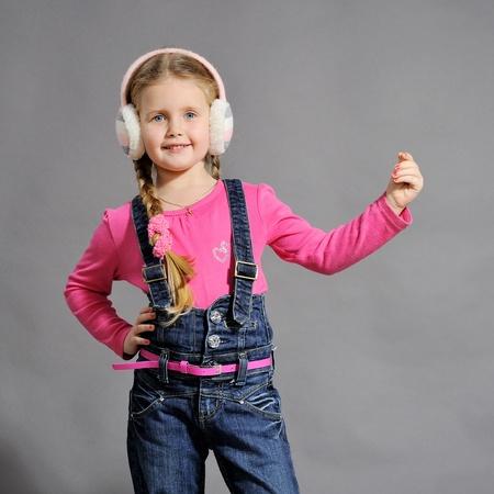 little girl in studio on gray background Stock Photo - 11730088