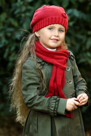 portrait of a little girl in autumn coat