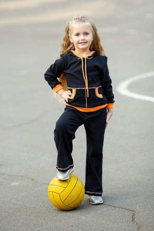 portrait of a young girl with soccer ball photo