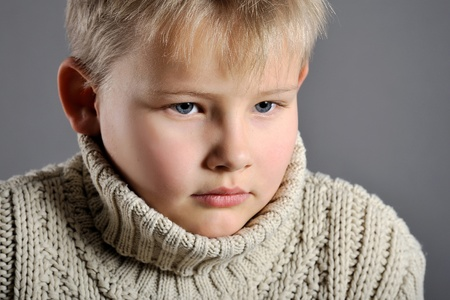 portrait of a young boy in the studio on a gray background Stock Photo - 11730130
