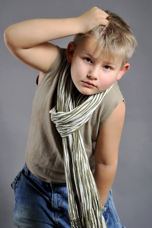 portrait of a young boy in the studio on a gray background Stock Photo - 11730131