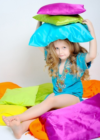 portrait of a little girl who played with colored pillow Stock Photo