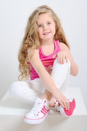 portrait of a young girl in sportswear photo