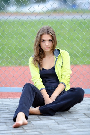 tracksuit: portrait of a young girl in a tracksuit Stock Photo