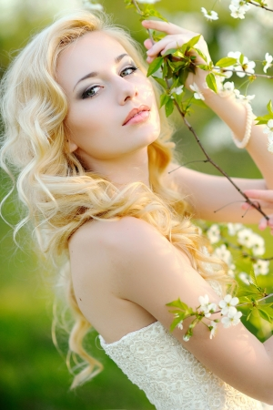 portrait of a beautiful bride in a lush garden