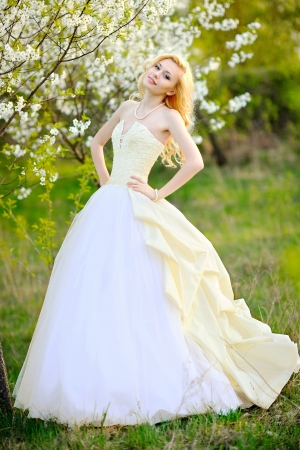 portrait of a beautiful bride in a lush garden photo