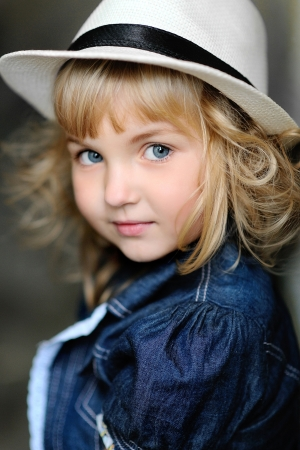 hat with feather: portrait of a Beauty and fashion child girl