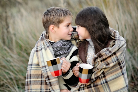 Portrait of boy and girl with plaid
