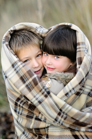 portrait of little boy and girl outdoors  Stock Photo