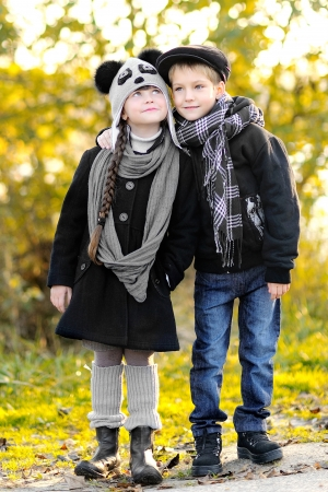 portrait of little boy and girl outdoors in autumn Stock Photo - 16383283