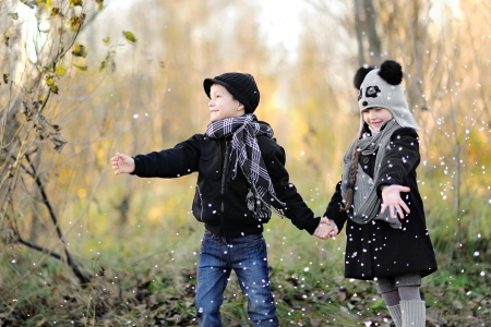 portrait of little boy and girl outdoors in autumn Stock Photo - 16335722