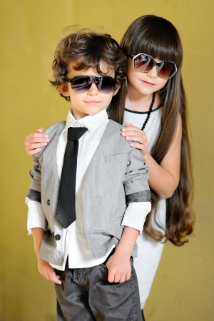 portrait of stylish little boy and girl outdoors  photo