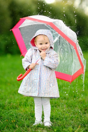 girl in rain: portrait of a little girl with umbrella