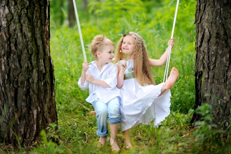 portrait of little boys and girls outdoors in summer
