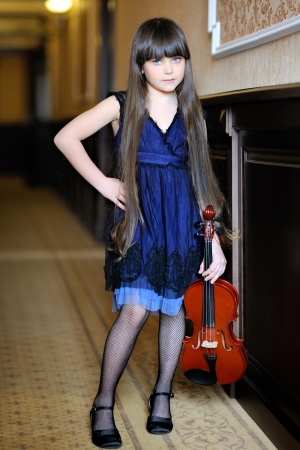 portrait of a little girl with a violin Stock Photo