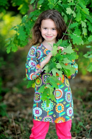 portrait of little girl outdoors in summer Stock Photo - 20020981