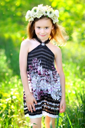 portrait of little girl outdoors in summer Stock Photo - 20020973