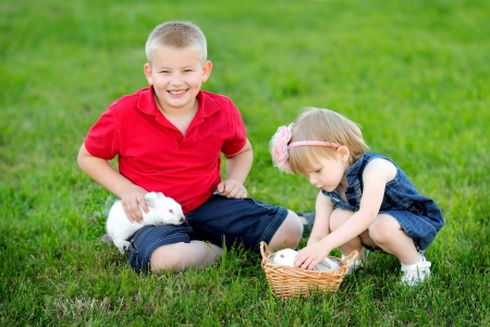 portrait of little boy and girl outdoors  photo