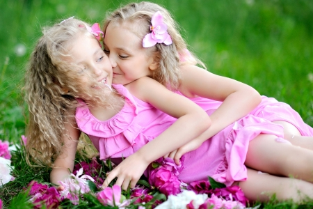 portrait of two twins with peonies photo