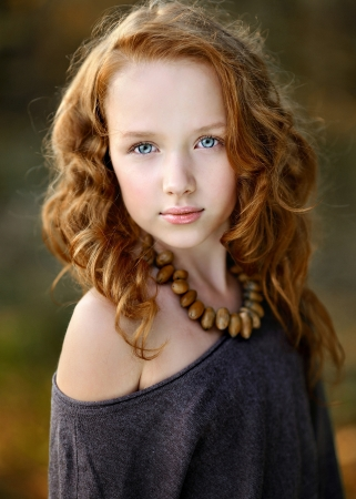 portrait of a beautiful little redhead girl