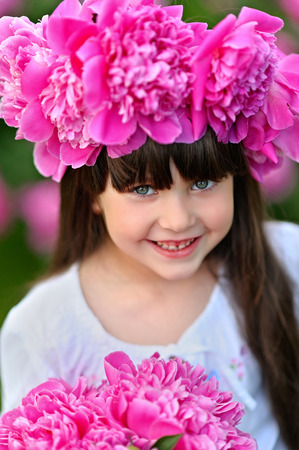 mirth: portrait of little girl outdoors in summer Stock Photo