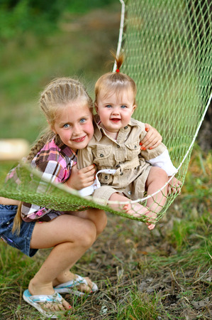 mirth: portrait of two sisters in a hammock Stock Photo