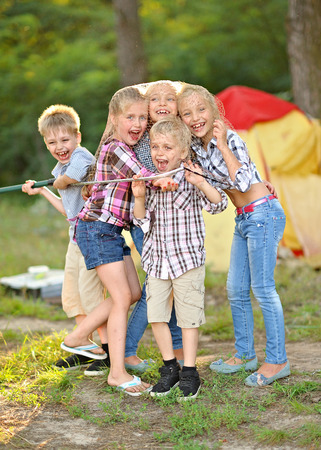 mirth: Portrait of young children on a camping holiday