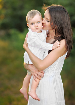portrait of mother and little boyr in summer